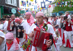 Costume worn by Old Oss supporters on May Day wearing all white with red tokens